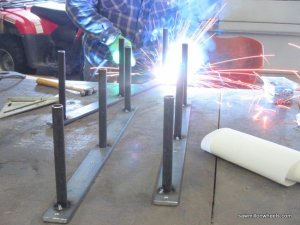 Welding live edged shelf brackets.
