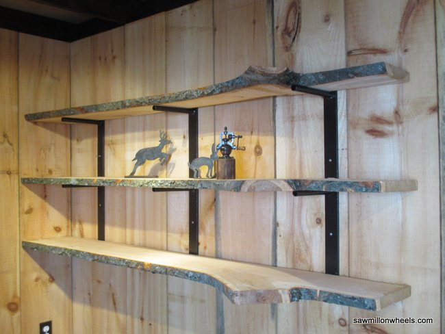 Live edge black cherry live edge shelves with steel brackets.